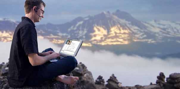 student on a mountain learning a language through his compter